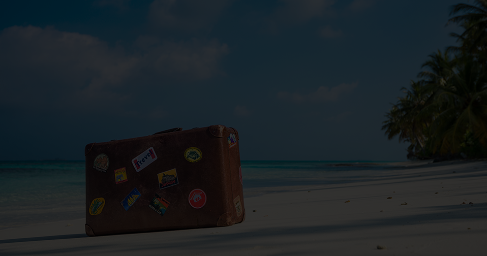 Brown suitcase on the beach.