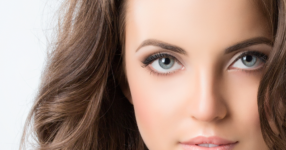 Woman with brown hair and beautiful eyes.