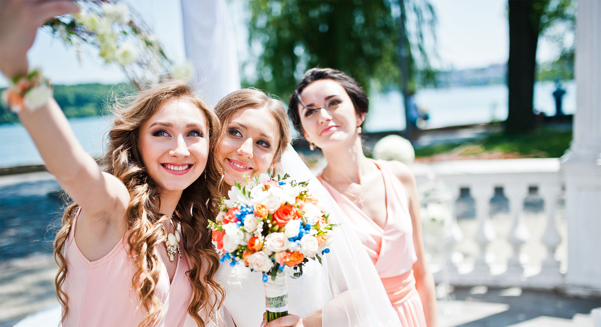 Bridesmaids taking a selfie.