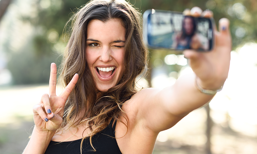 Woman taking a selfie of herself.